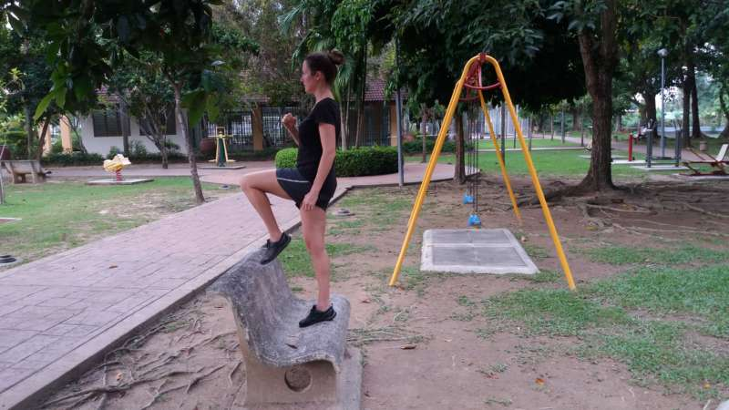 Bench step-up playground exercise - up position