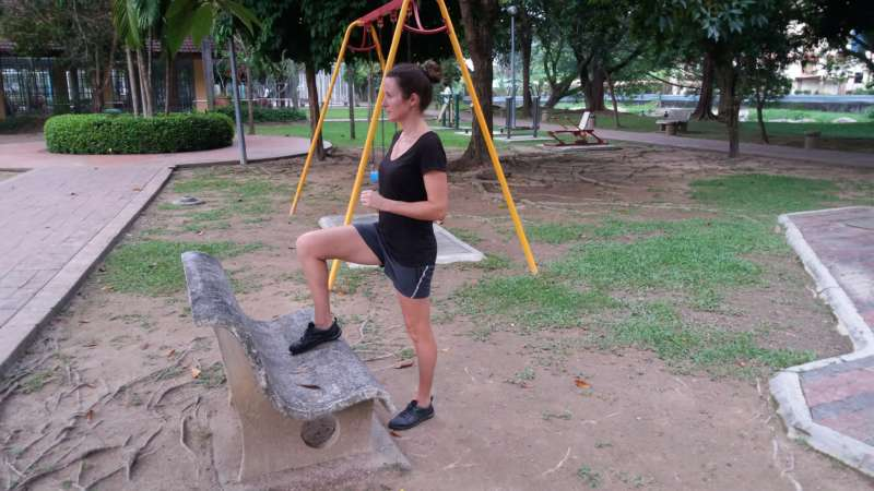 Bench step-up playground exercise - down position
